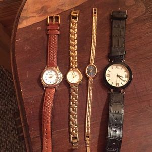 Set of 4 watches some with diamonds.